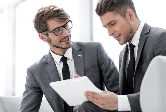 Image of two successful business partners working at meeting in